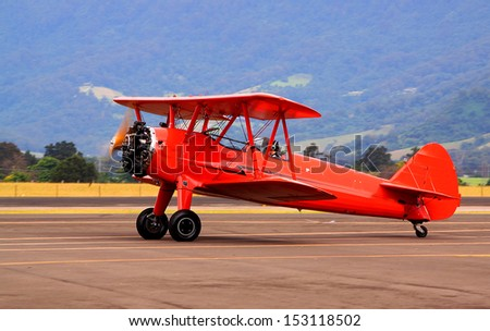 Bringing back old times - biplane - stock photo