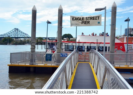 BRISBANE, AUS - SEP 25 2014:CityFerry at Eagle Street Pier ferry wharf in Brisbane, Australia.Brisbane City Council operates a fleet of City Ferries along a network of 24 terminals on Brisbane river. - stock photo