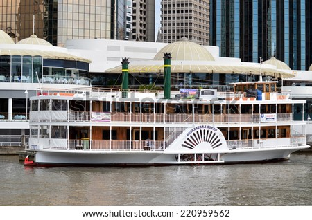 BRISBANE, AUS - SEP 25 2014: Riverboat mooring at Eagle Street Pier. It is an iconic waterfront precinct with world class dining options and unrivaled views of the Brisbane River. - stock photo