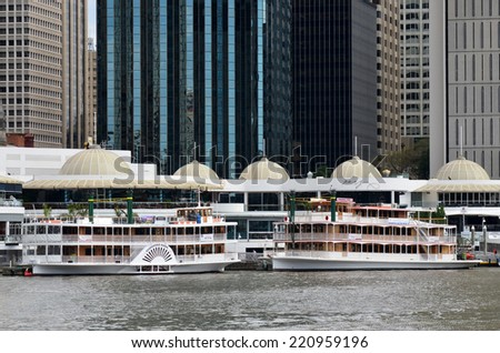 BRISBANE, AUS - SEP 25 2014: Riverboats mooring at Eagle Street Pier. It is an iconic waterfront precinct with world class dining options and unrivaled views of the Brisbane River. - stock photo