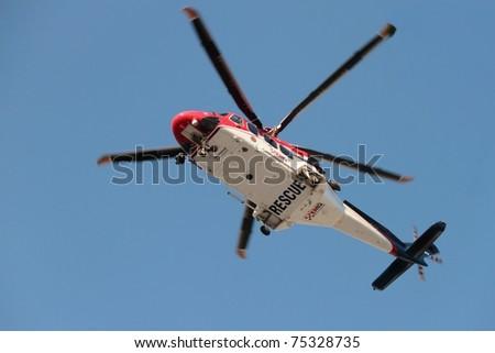 BRISBANE, AUSTRALIA - APR 14 : EMQ emergency helicopter making patient rescue landing at Royal Brisbane Hospital on April 14, 2011 in Brisbane, Australia - stock photo