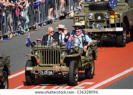BRISBANE, AUSTRALIA - APRIL 25 : Older veterans driven along march route during Anzac day commemorations  April 25, 2013 in Brisbane, Australia - stock photo