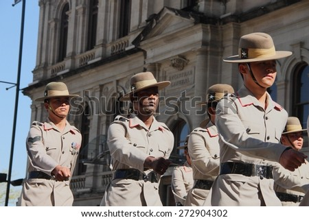 BRISBANE, AUSTRALIA - APRIL 25 : Soldiers march along the route during Anzac day centenary commemorations April 25, 2015 in Brisbane, Australia - stock photo
