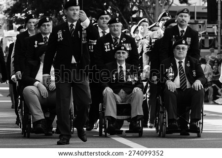 BRISBANE, AUSTRALIA - APRIL 25 : South African veterans march during Anzac day centenary commemorations April 25, 2015 in Brisbane, Australia - stock photo