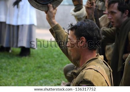 BRISBANE, AUSTRALIA - APRIL 25 : Unidentified World War 2 reenactors give cheers during Anzac day commemorations  April 25, 2013 in Brisbane, Australia - stock photo