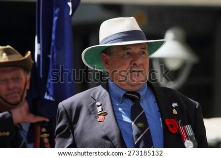 BRISBANE, AUSTRALIA - APRIL 25 : Veterans march along the route during Anzac day centenary commemorations April 25, 2015 in Brisbane, Australia - stock photo