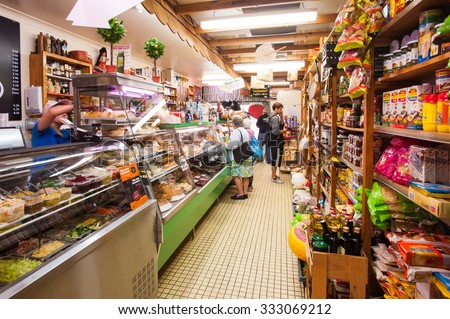 BRISBANE, AUSTRALIA,  CIRCA JUNE 2012: customers shopping in a local deli in Brisbane. Family run small businesses are being wooed by both major political parties in the lead up to the Federal Election. - stock photo