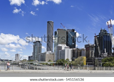 BRISBANE, AUSTRALIA - December 28, 2016: People crossing Victoria Bridge towards the modern city of Brisbane, Australia