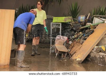 BRISBANE, AUSTRALIA - JAN 14 : Flood  Brisbane Fairfield area community volunteers clean up January 14, 2011 in Brisbane, Australia - stock photo