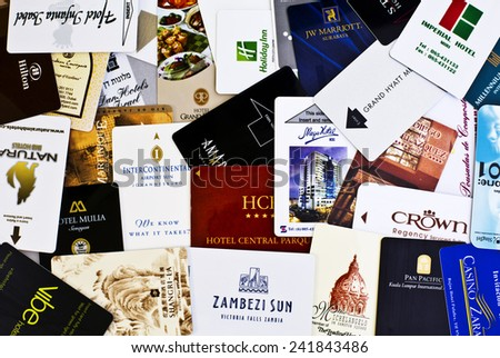 BRISBANE, AUSTRALIA - JANUARY 6, 2015: Electronic hotel room keys from around the world. Collage of real keycards. - stock photo