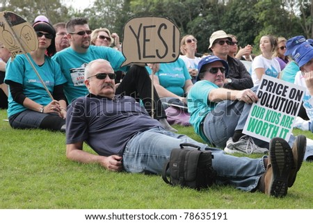 BRISBANE, AUSTRALIA - JUNE 6 : crowds with say Yes and  pro carbon tax signs listening to rally speakers during World Environment Day say yes protest 6, 2011 in Brisbane, Australia - stock photo