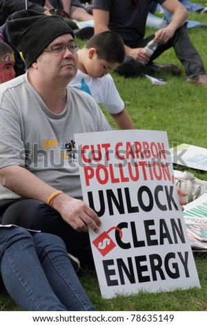 BRISBANE, AUSTRALIA - JUNE 6 : man with clean energy protest sign at say Yes rally  during World Environment Day 6, 2011 in Brisbane, Australia - stock photo