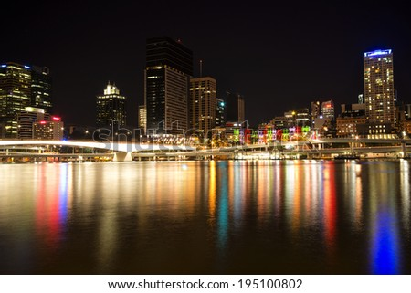 Brisbane, Australia - May 24th, 2014: Cityscape of Brisbane city CBD in Australia on a clear night with water reflections.