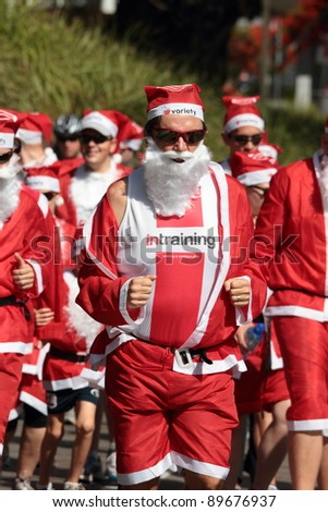 BRISBANE, AUSTRALIA  NOV 27 :Unidentified santa in training outfit during Variety Santa Fun Run November 27, 2011 in Brisbane, Australia - stock photo