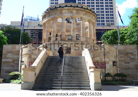 Brisbane, Australia - November 29, 2011: Anzac War Memorial on the heritage-listed town square called Anzac Square with no people and office buildings of the Brisbane CBD - stock photo