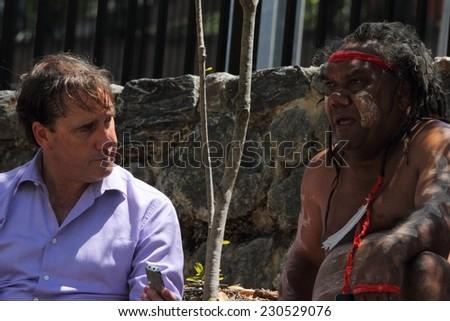 BRISBANE, AUSTRALIA - NOVEMBER 14: International media interviewing aboriginal leader during g20 aboriginal deaths in custody protest on November 14, 2014 in Brisbane, Australia - stock photo