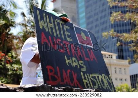 BRISBANE, AUSTRALIA - NOVEMBER 14: Unidentified protester holding accountability sign during g20 aboriginal deaths in custody protest on November 14, 2014 in Brisbane, Australia - stock photo