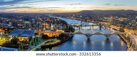 Brisbane City, Beautiful Panorama Aerial View of Kurilpa Bridge, William Jolly Bridge and Merivale Bridge over Brisbane River Cityscape, GOMA and Light Trails at Summer Sunset, Queensland, Australia - stock photo