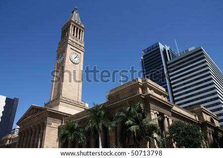 Brisbane City Hall and modern architecture in background.