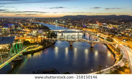Brisbane City, Panorama Aerial Sunset View of Kurilpa Bridge, William Jolly Bridge and Merivale Bridge over Brisbane River with Cityscape Skyline at Twilight Dusk in Summer, Queensland, Australia - stock photo