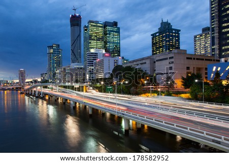 Brisbane, QLD - April 16: Traffic streams along the Pacific Motorway and Victoria Bridge during rush hour at dusk on April 16, 2013.