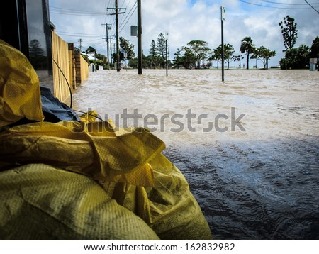 BRISBANE, QLD, AUSTRALIA - January 27: Sandbags protecting a local business during the floods in Sandgate, Brisbane on 27 January 2013 - stock photo