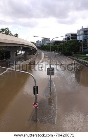 BRISBANE, QUEENSLAND/AUSTRALIA - JANUARY 13: Flooded street on January 13, 2011 in Milton, Brisbane, Queensland, Australia. - stock photo