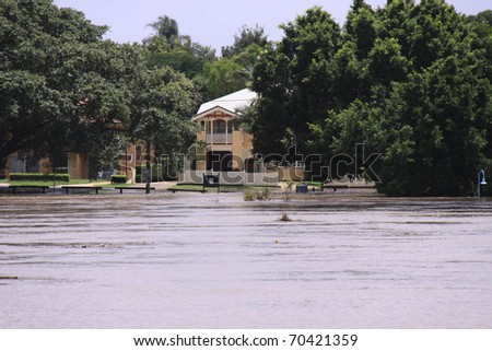 BRISBANE, QUEENSLAND/AUSTRALIA - JANUARY 13: Flooded street with look on the Brisbane river on January 13, 2011 in Toowong, Brisbane, Queensland, Australia. - stock photo