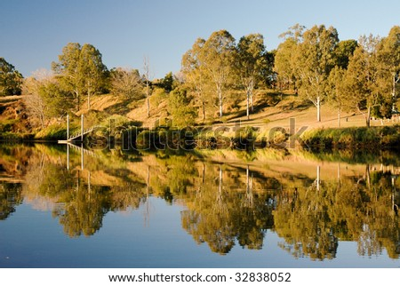 Brisbane River at Moggill reflecting it's surroundings - stock photo
