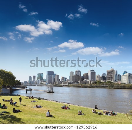 brisbane skyline from the park and people in lawn , queensland, Australia - stock photo