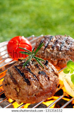 Brisket Burgers on the grilling pan with open flames - stock photo