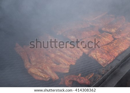 Brisket smoking on the grill for barbecue  - stock photo