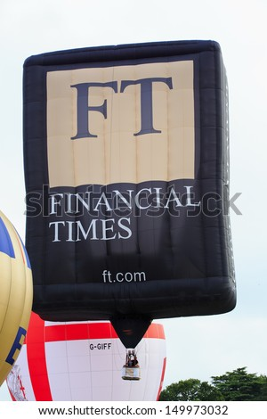 BRISTOL, ENGLAND - AUGUST 10: Financial Times balloon takes off at the 6pm mass ascent at the Bristol International Balloon Fiesta, England, August 10, 2013 - stock photo