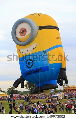 BRISTOL, ENGLAND - AUGUST 10: The Despicable Me 2 balloon takes off at the 6pm mass ascent at the Bristol International Balloon Fiesta, England, August 10, 2013 - stock photo