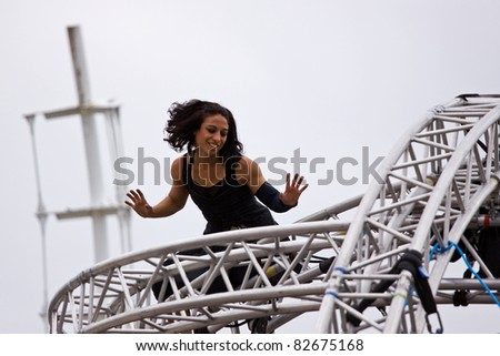 BRISTOL, ENGLAND - JULY 30: An artiste gives an aerial performance in the Dance Village at the Harbour Festival in Bristol, England on July 30, 2011. The three day event attracted 280,000 spectators - stock photo