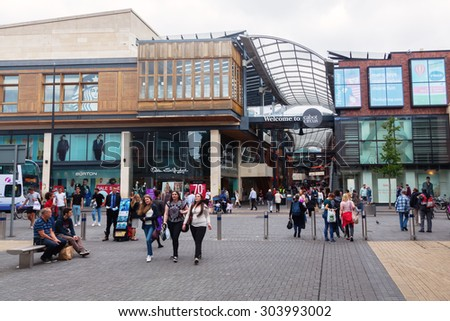 BRISTOL, ENGLAND - JULY 08, 2015: Entrance of Cabot Circus in Broadmead, Bristol, with unidentified people. It is a shopping centre opened 2008 after 10year planning and project costing of BP 500 mio - stock photo