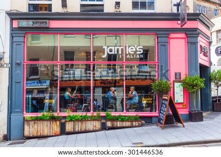 BRISTOL, ENGLAND - JULY 08, 2015: Jamie Oliver restaurant with unidentified people. He is an English celebrity chef known for food tv shows, cookbooks and global campaign for better food education  - stock photo