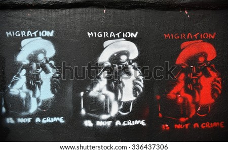 BRISTOL - OCT 31: View of Paddington Bear migration themed graffiti by street artist Banksy on a city centre wall on Oct 31, 2015 in Bristol, UK. Immigration policy is a reoccurring topic in the UK. - stock photo