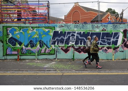 BRISTOL - SEPT 21: Graffiti piece by an unidentified artist on a building in the Stokes Croft area of the city on Sept 21, 2012 in Bristol, UK. Bristol is famed for its vibrant street art scene.  - stock photo