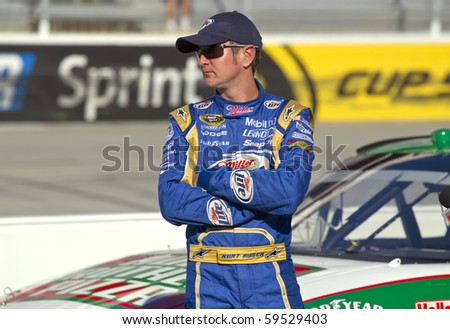 BRISTOL, TN - AUG 20:  Kurt Busch watches other cars qualify for the Irwin Tools Night Race race at the Bristol Motor Speedway in Bristol, TN on Aug 20, 2010. - stock photo