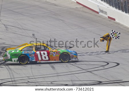 BRISTOL, TN - MAR 20:  Kyle Busch sweeps the weekend winning the Jeff Byrd 500 NASCAR Sprint Cup race at the Bristol Motor Speedway in Bristol, TN on Mar 20, 2011. - stock photo