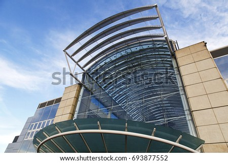 Bristol, UK: December 14, 2016: Main entrance to Cribbs Causeway Shopping Mall in Bristol with a glass facade and restaurants on the mezzanine level.
