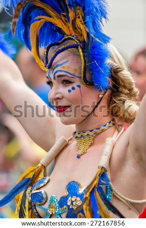 Bristol, UK. 5th July 2014. Close-up of woman from the Showgirl Academy performing at Bristol's St. Paul's carnival - stock photo