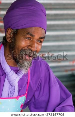 Bristol, UK. 5th July 2014. Man serving Vegan Delights - close up - stock photo