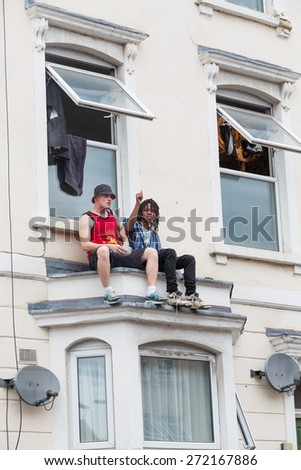Bristol, UK. 5th July 2014. Two friends take a ringside view at St Paul's Carnival - stock photo