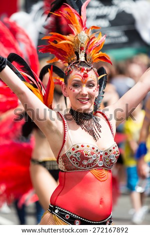 Bristol, UK. 5th July 2014. Woman from the Showgirl Academy performing at Bristol's St. Paul's carnival - stock photo