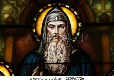 BRISTOW, VIRGINA - APRIL 26, 2015: Stained glass window depicting close up of face of St. Benedict of Nursia, located in chapel of St. Benedict Monastery - stock photo