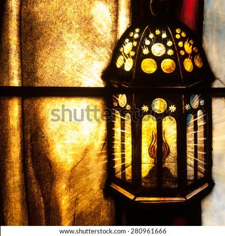 BRISTOW, VIRGINIA - APRIL 26, 2015: Detail of stained glass window depicting a lighted lantern, located in chapel of St. Benedict Monastery - stock photo