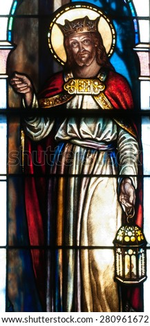 BRISTOW, VIRGINIA - APRIL 26, 2015: Stained glass window of Jesus Christ as Christ the King carrying a lantern and knocking on a door, located in chapel of St. Benedict Monastery - stock photo
