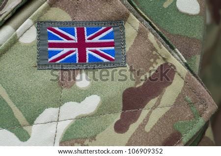 British army camouflage uniform with Union Jack flag - stock photo